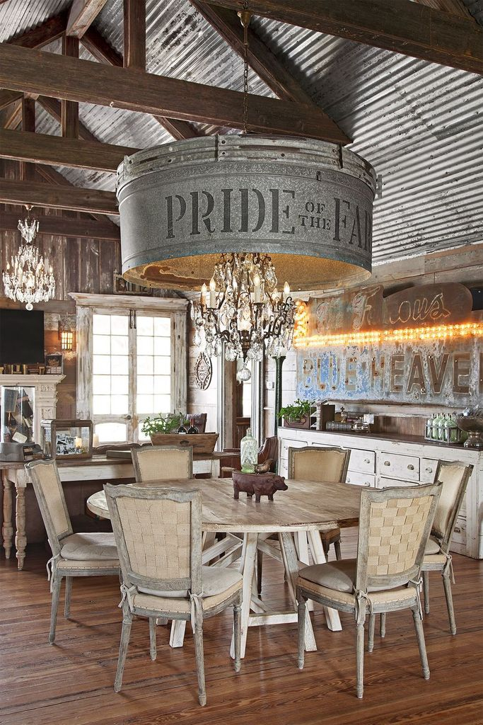 Farmhouse dining room design with unique chandelier