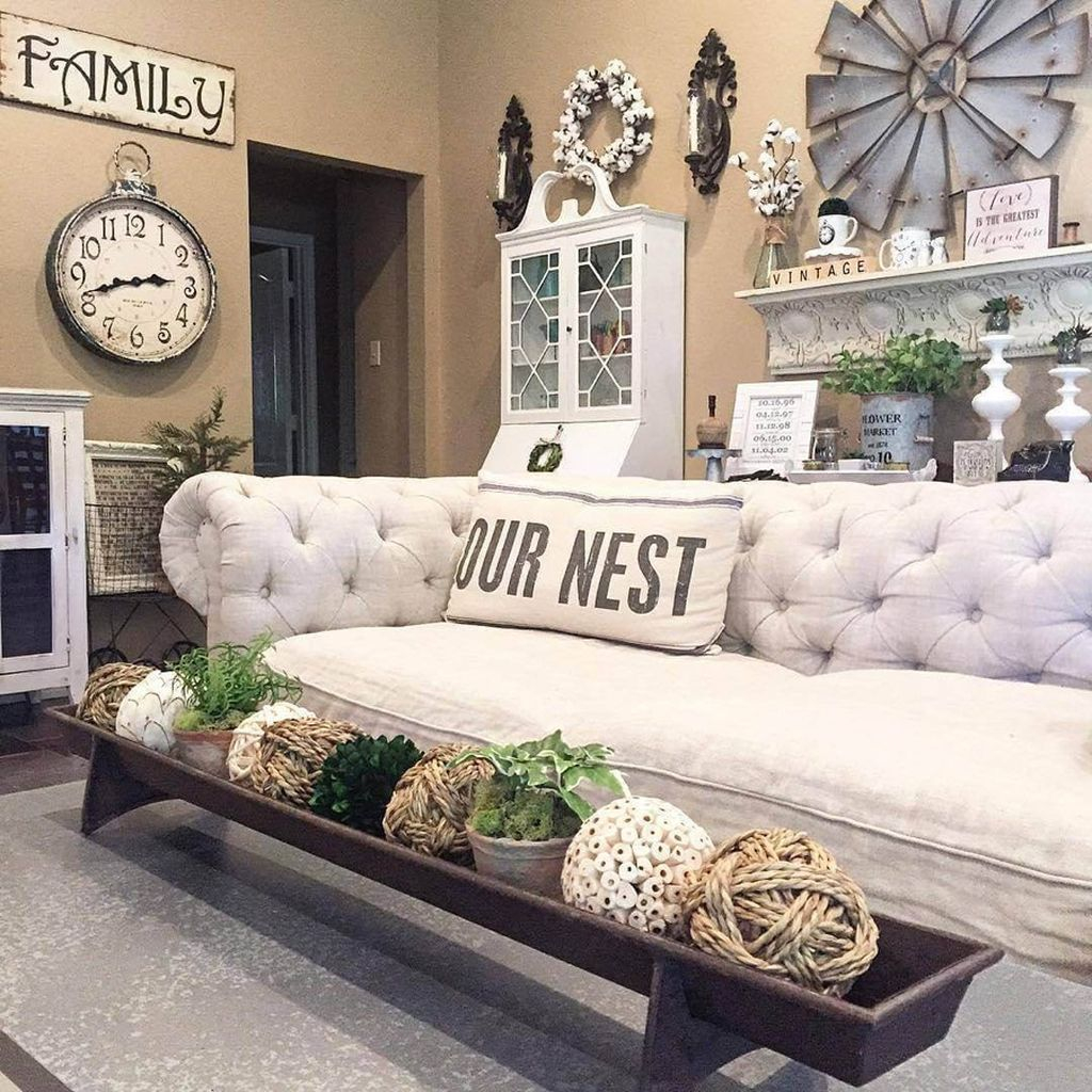 Farmhouse living room decoration with ball in rope material combined with white wreath and old windmill on the wall to perfect your living room