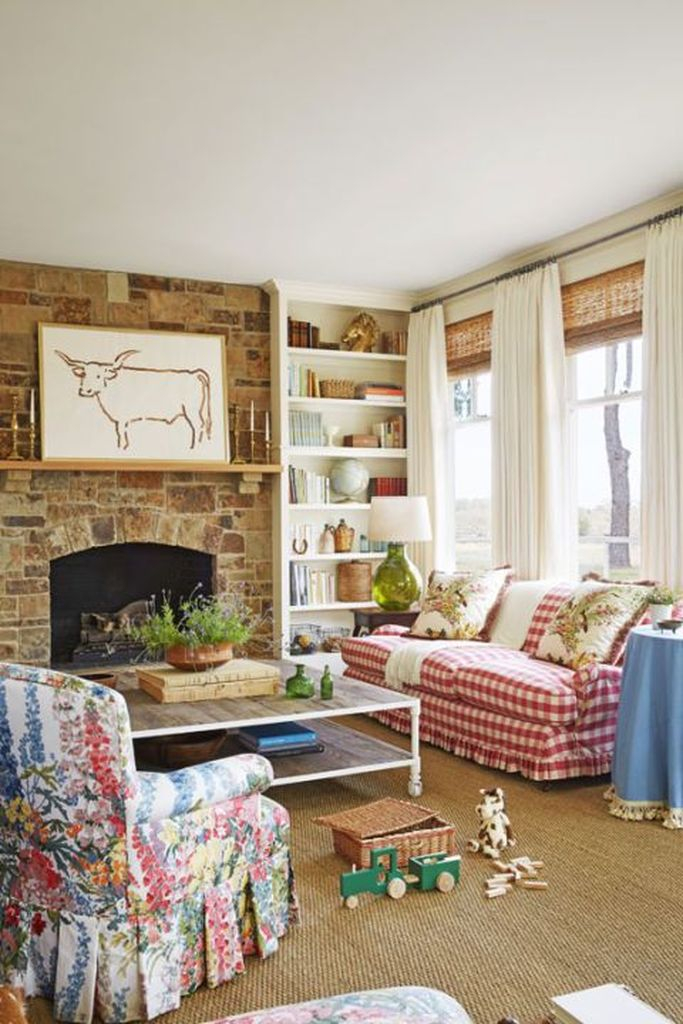 Farmhouse living room design with stone fireplace