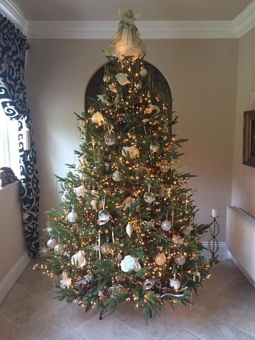 Green chrismast tree with white ornament and yellow light