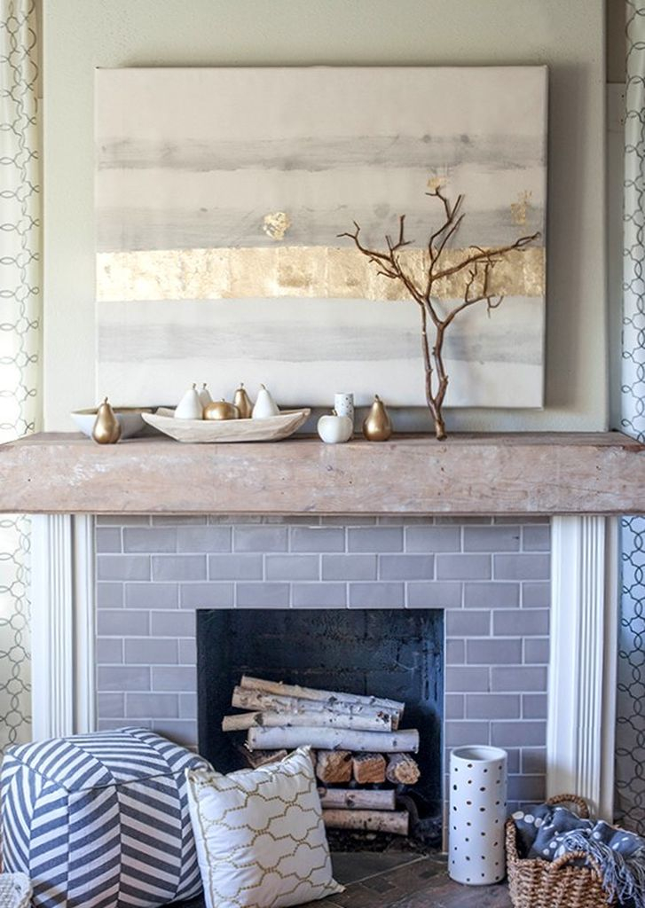 Grey brick fireplace combined with branch above it