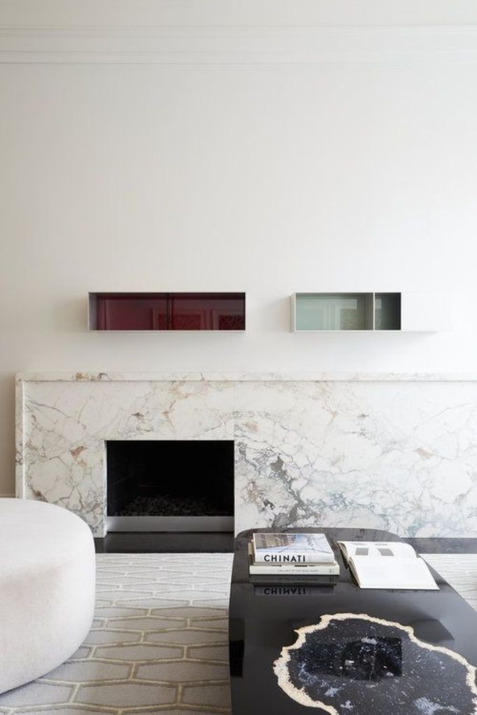 Marble fireplace and glossy floating shelves