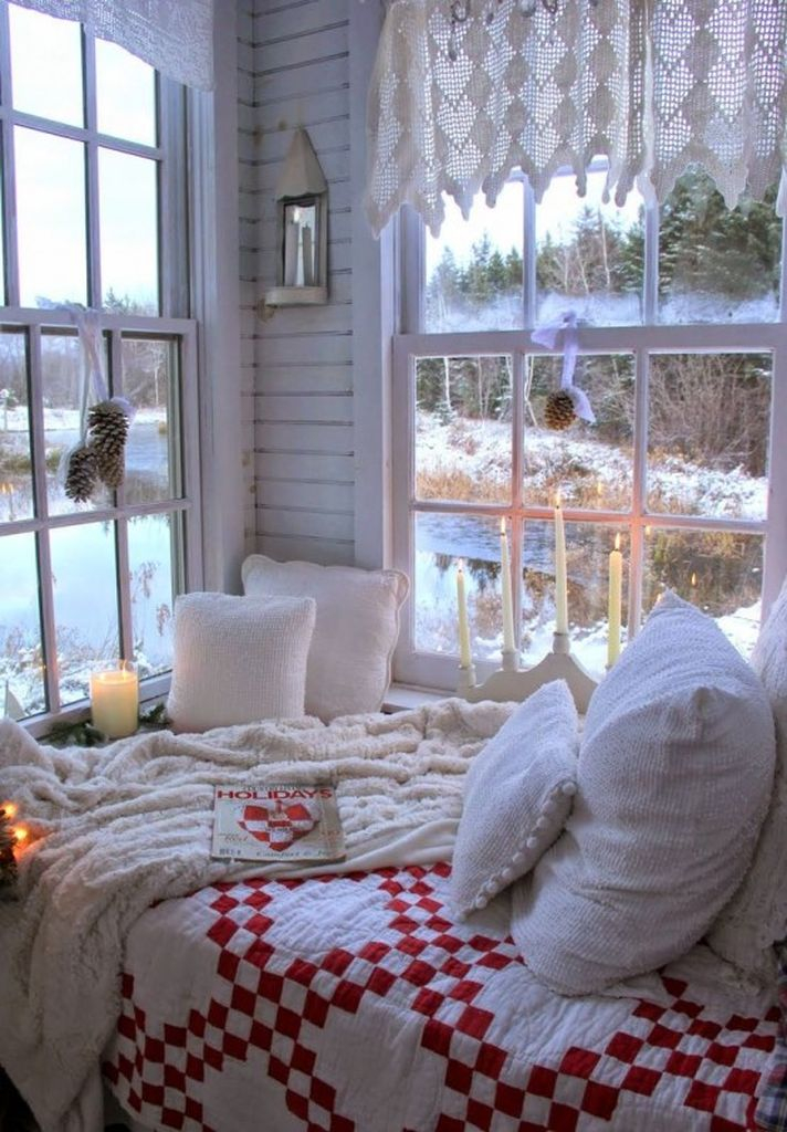 Simple winter bedroom with white crochet curtains and pinecone posies