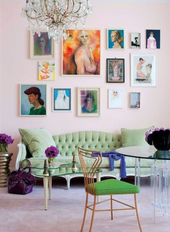 The-pieces-in-this-bright-gallery-wall-designed-by-holly-becker-provide-subtle-moments-of-pink-and-green-to-tie-the-walls-and-furnishings-together-but-also-add-in-pops-of-blue-red-and-white.