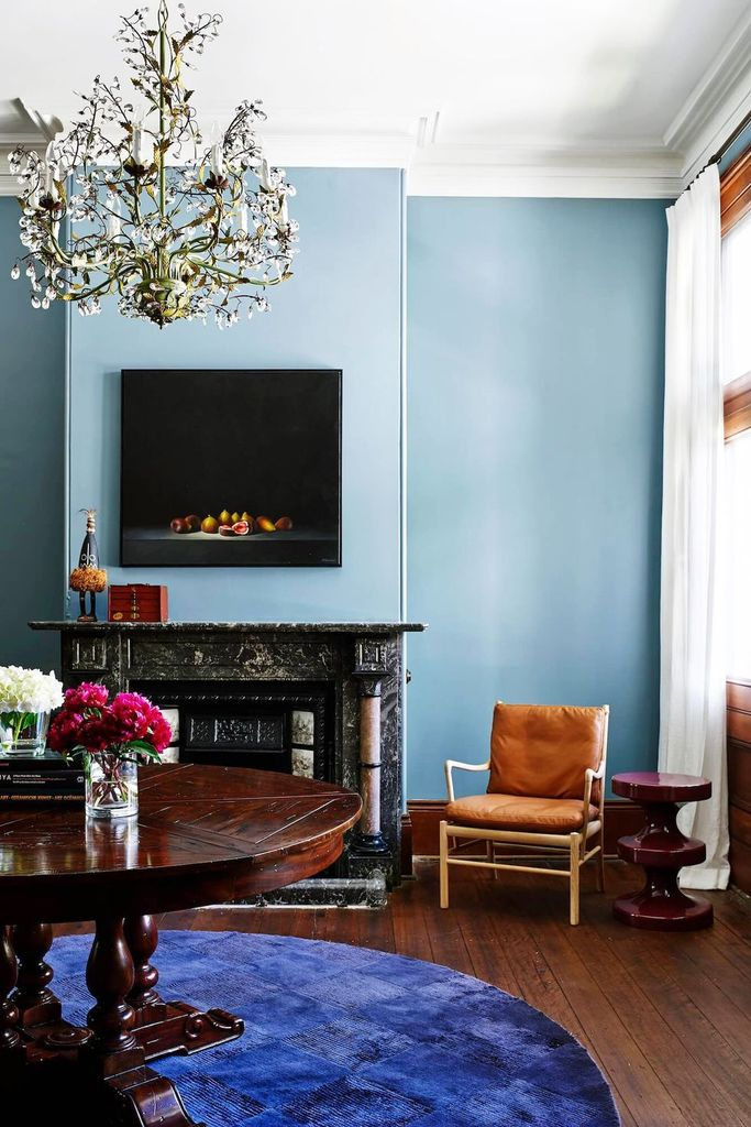 Unique fireplace combined with blue walls