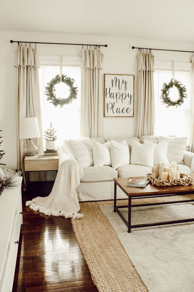White-farmhouse-living-room-with-hanging-wreath-on-the-window-to-perfect-your-living-room