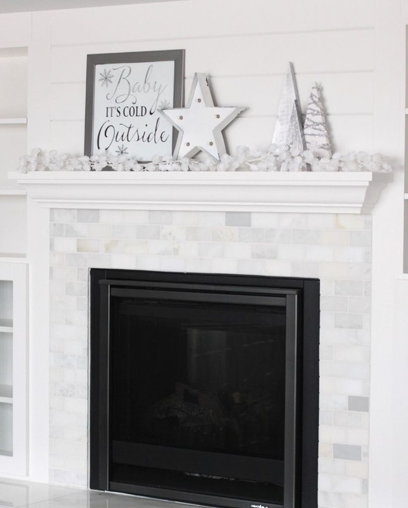 White fireplace combined with winter ornament