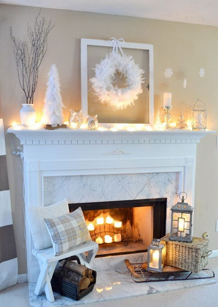 White fireplace with wreath above it