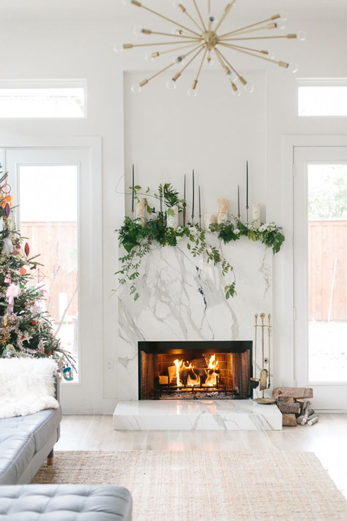 White granite fireplace combined with greenery