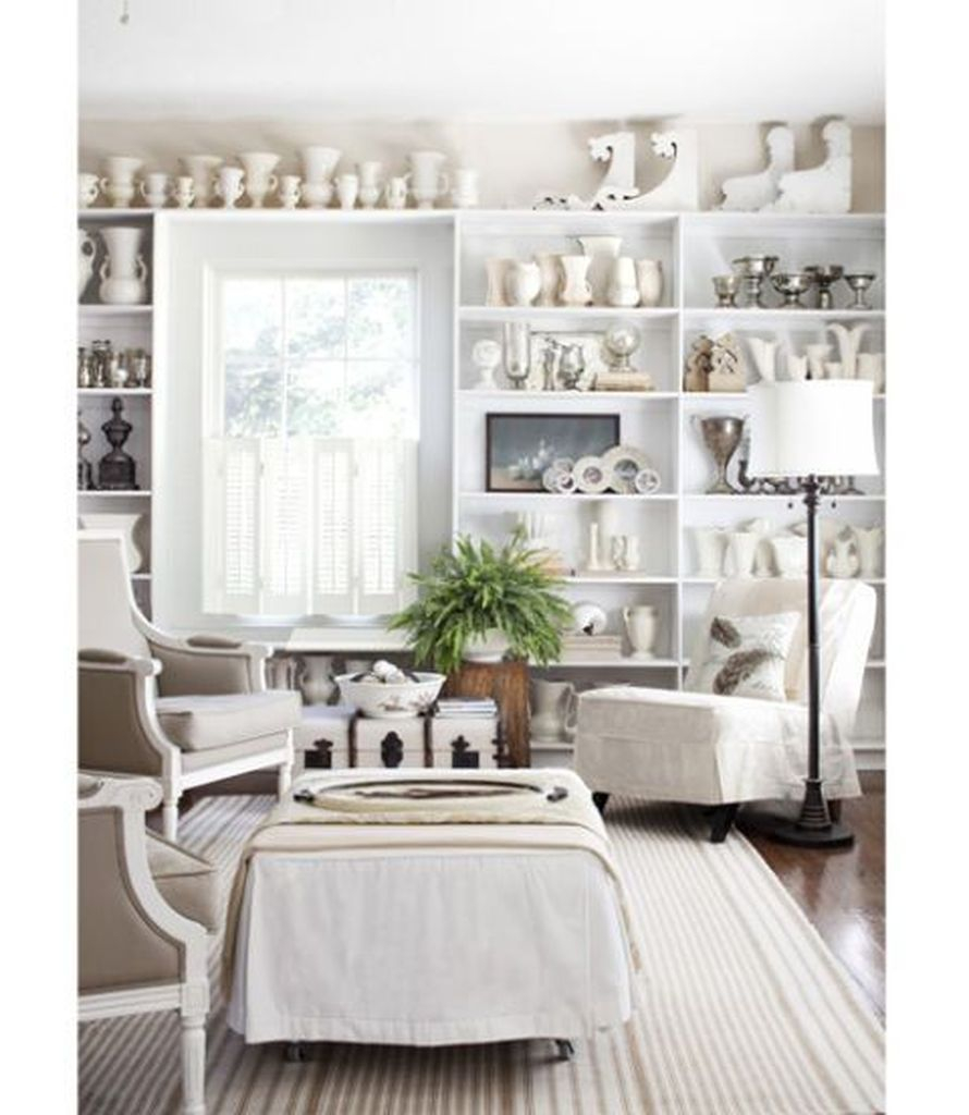 White walls combined with white shelves for living room