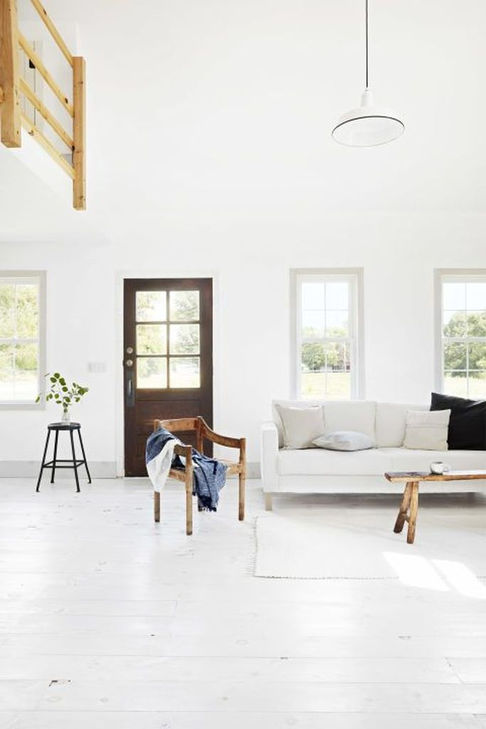White walls, floors, molding, and furniture for living room