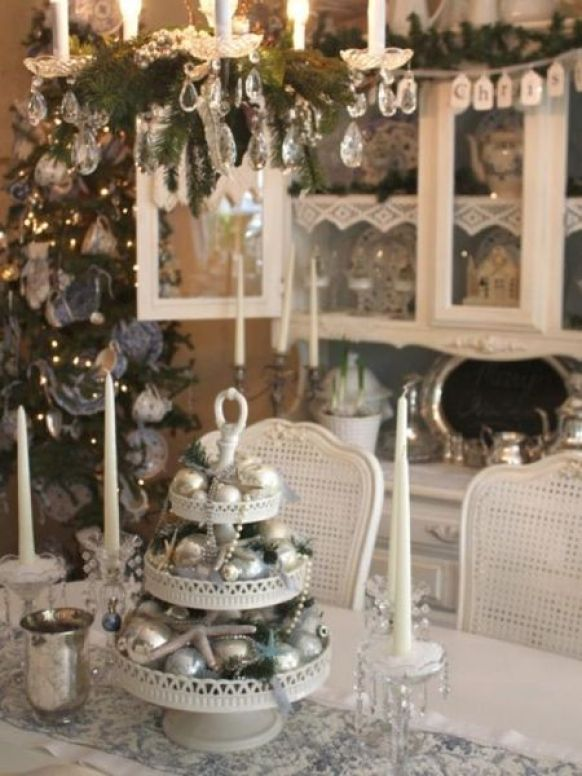 A-three-tiered-centerpiece-featuring-silver-ornament-balls.
