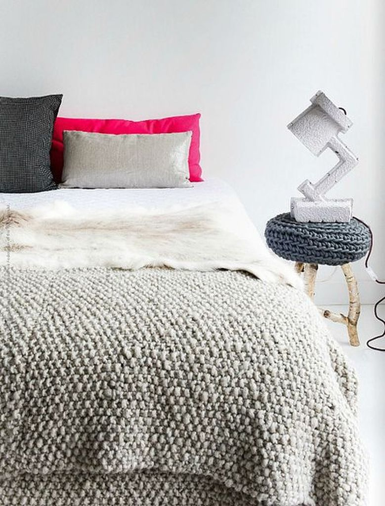 Bedroom with knit blankets and pillows