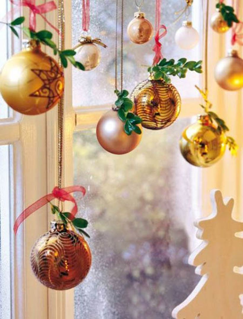 Christmas window with gold hanging lamps ornament
