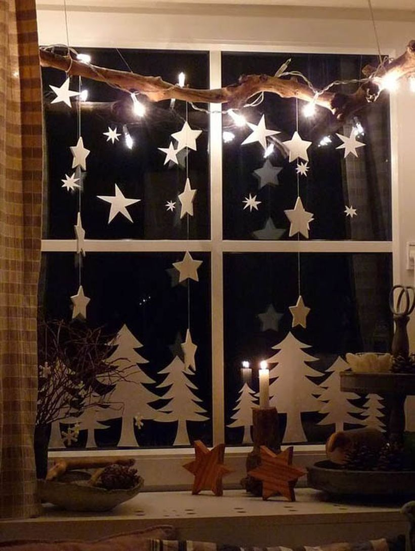 Christmas window with white tree and small white stars