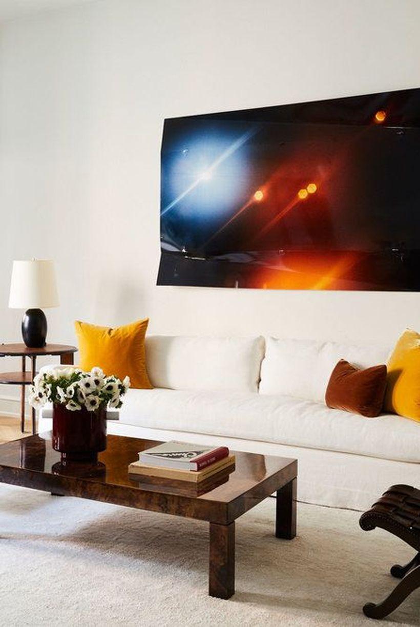 Yellow and brown cushion with white sofa