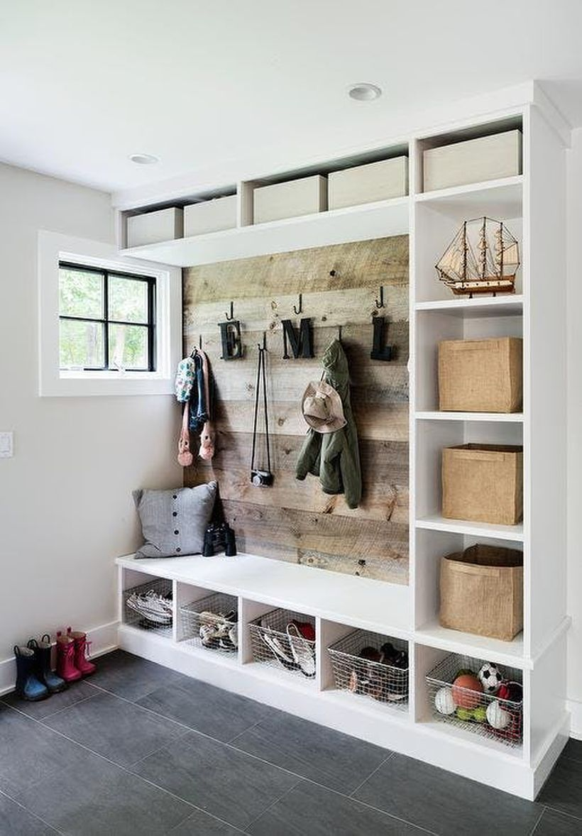 Mudroom-with-rustic-back-wall-via-z-interiors