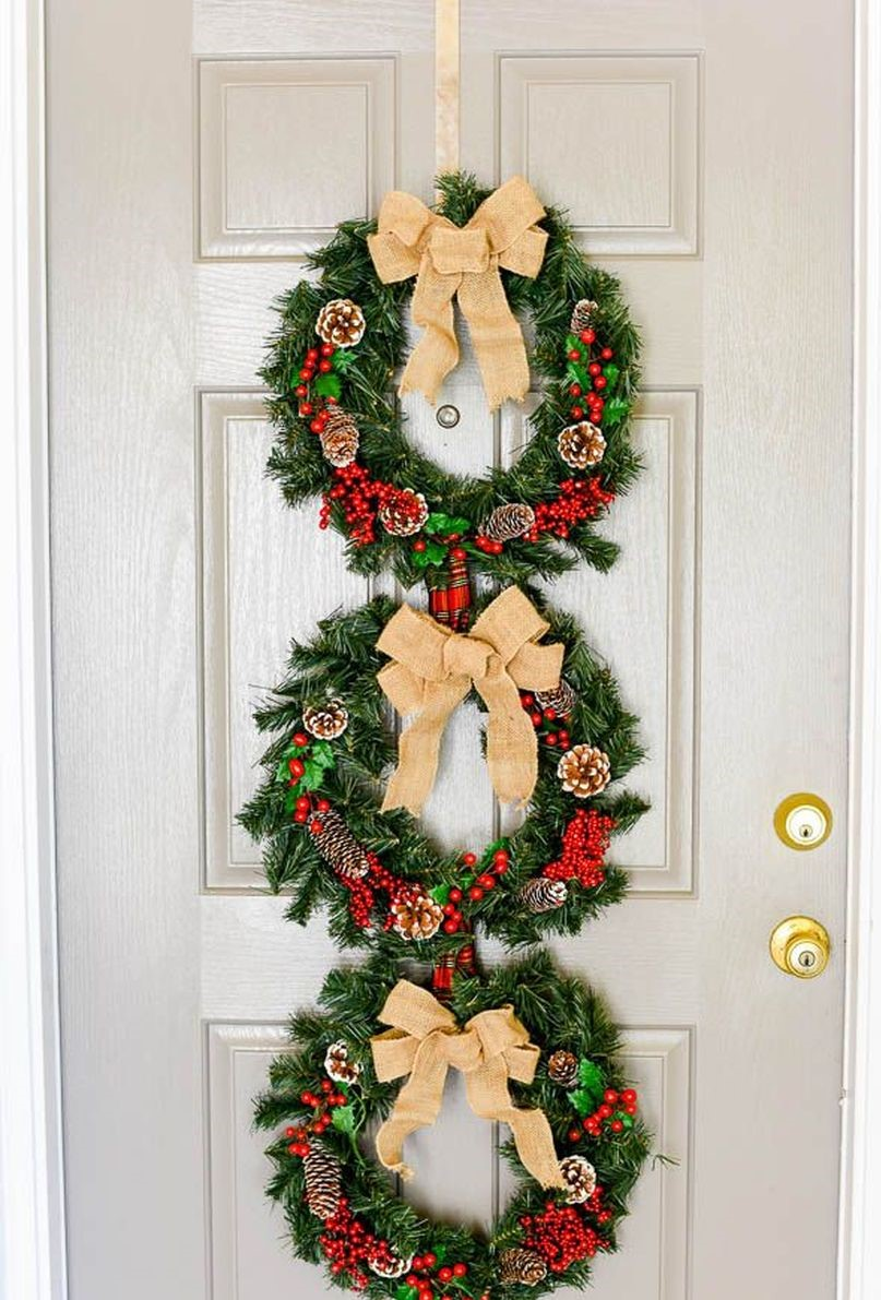 Welcoming-christmas-front-door-with-wreath-trio-to-welcome-and-charm-every-guest-you'll-have.-1