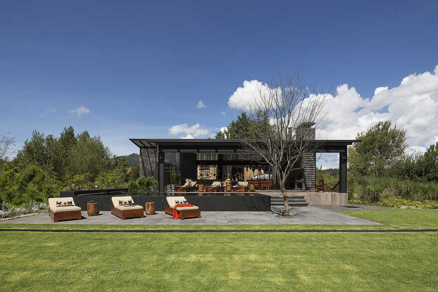 Dark grey house in modern construction of purified lines with rustic touches 1