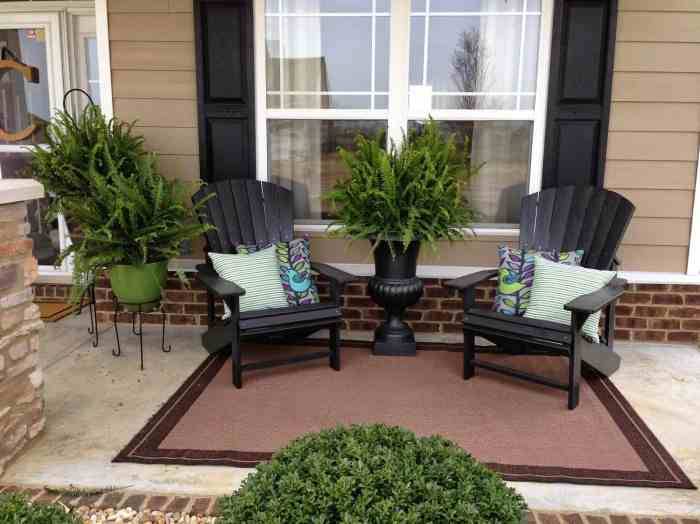 Front-porch-decorated-with-adirondack-chairs-and-potted-plants_home-elements-and-style