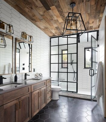 Gorgeous-industrial-farmhouse-style-bathroom-with-hexagonal-gray-floor-tiles.-wooden-ceiling-and-lovely-dark-framed-shower-area-81569