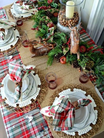 03-a-lush-evergreen-garland-with-pinecones-apples-deer-figurines-and-a-candle-lantern-with-nuts