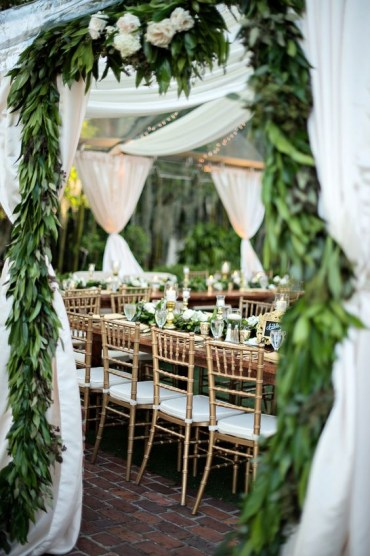 1 03-a-wedding-tent-with-greenery-garlands-all-over