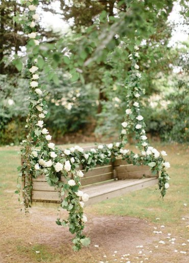 1 07-blush-flowers-and-greenery-for-deccorating-a-hanging-bench