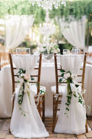 1 08-white-fabric-and-blush-flowers-for-decorating-chairs