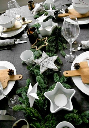 1-25-a-table-setting-with-faux-evergreens-star-shaped-candle-holders-and-pinecones