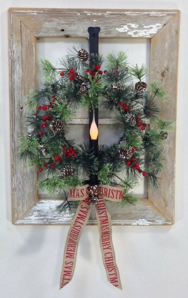 13-a-window-frame-wreath-of-faux-evergreens-berries-and-pinecones-with-a-burlap-bow-and-a-light