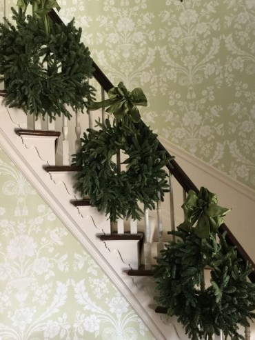 14-a-trio-of-evergreen-wreaths-with-emerald-ribbon-bows-for-decorating-stairs