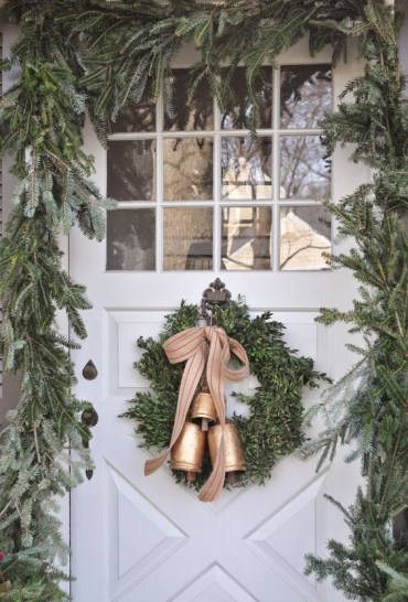 15-a-lush-evergreen-garland-to-frame-the-font-door-and-a-wreath-with-bells-to-match-the-look