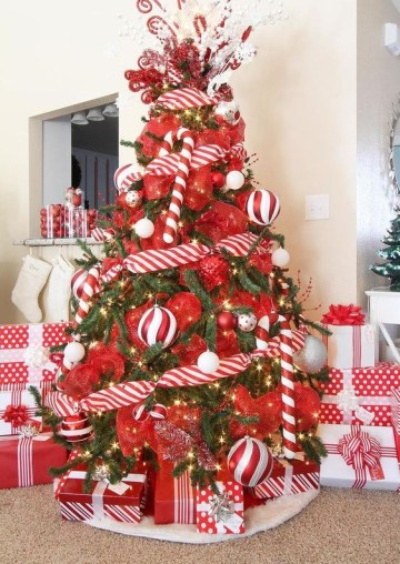 2 a-colorful-christmas-tree-decorated-with-lights-red-and-red-and-white-ribbons-overiszed-candy-canes-and-ornaments-is-ultimate-fun
