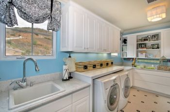 A-deep-sink-makes-for-a-more-ergonomic-laundry-room-design