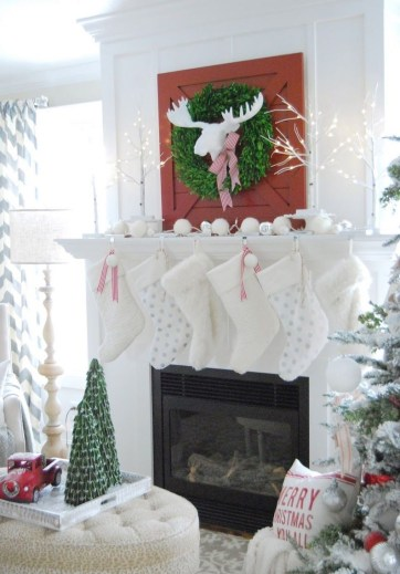 Christmas-mantel-with-red-barn-door-and-white-stockings-via-11magnolialane