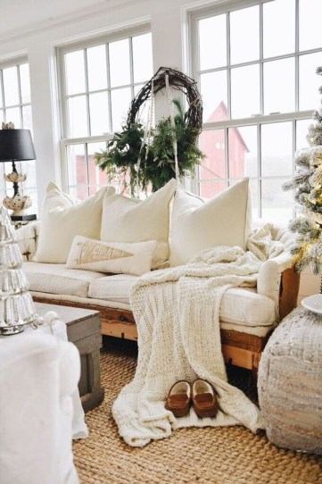 A-knit-blanket-and-lots-of-pillows-plus-a-jute-rug-make-the-living-room-welcoming-and-cozy