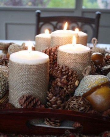 A-rustic-christmas-centerpiece-of-a-tray-pinecones-vine-balls-nuts-candles-covered-with-burlap-is-a-creative-idea
