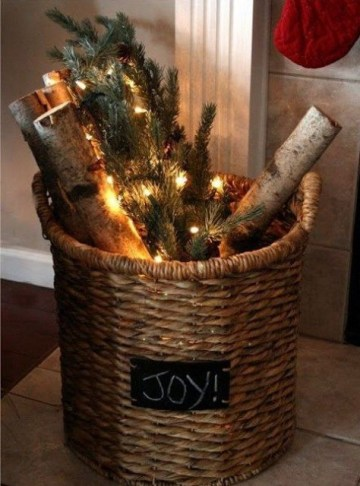 A-vine-basket-with-firewood-lights-and-evergreens-is-a-cool-decoration-for-both-indoors-and-outdoors