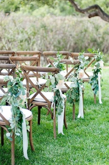 Eucalyptus-with-cream-ribbon-for-aisle-chairs