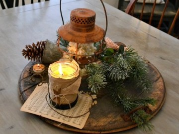 Rustic-christmas-decoration-ideas-christmas-table-centerpeice-candle-and-sheet-music