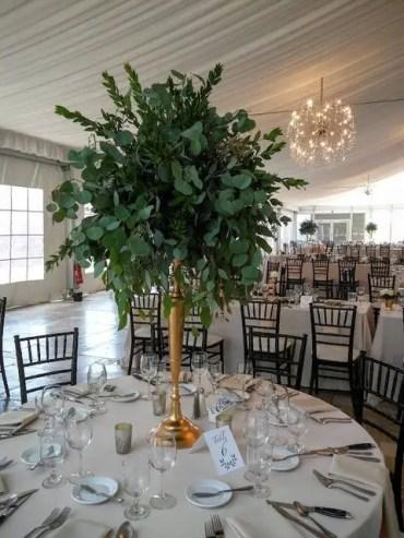 Tall-foliage-centerpiece-with-myrtle-seeded-eucalyptus-and-silver-dollar-eucalyptus