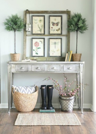 06-vintage-flora-and-fauna-posters-and-potted-plants-for-styling-a-console-for-spring