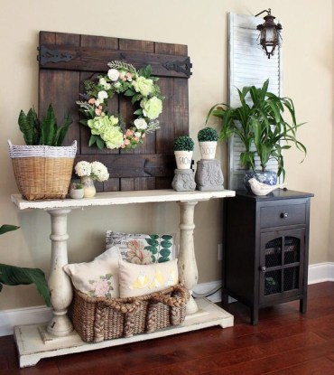 1 16-a-barn-door-with-a-faux-flowers-and-greeery-wreath-potted-succulents-and-boxwood-for-a-chic-look