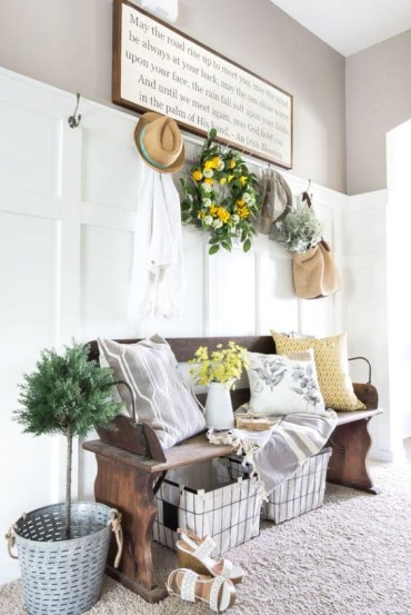 14-a-potted-plant-fresh-blooms-in-a-jug-and-a-colorful-bloom-and-greenery-wreath-over-the-bench