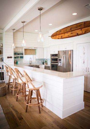 14-an-old-surf-attached-to-the-wall-in-the-kitchen-opposite-the-breakfast-area