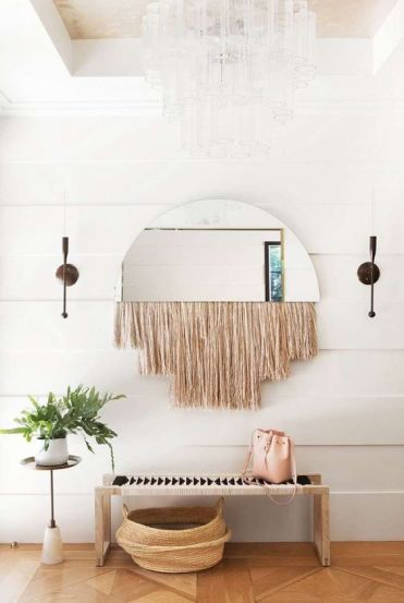 20-a-boho-space-with-a-woven-bench-a-woven-basket-a-mirror-with-fringe-and-a-potted-plant