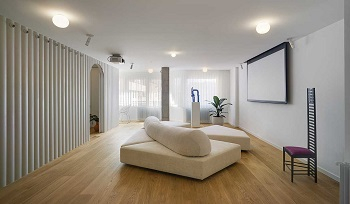 Contemporay white apartment with an open living space that feels dramatic 1