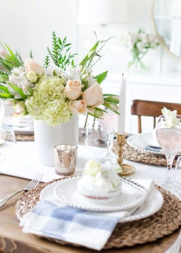 A-bright-spring-tablescape-with-wicker-chargers-checked-napkins-a-pastel-floral-centerpiece-and-some-mercury-glass-accessories