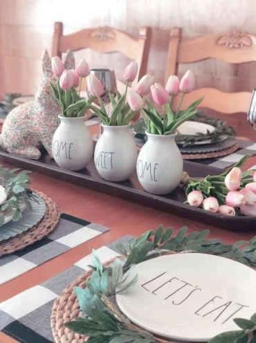 A-tray-with-a-floral-bunny-pink-tulips-in-vases-and-greenery-wreaths-for-each-place-setting-feel-spring-like